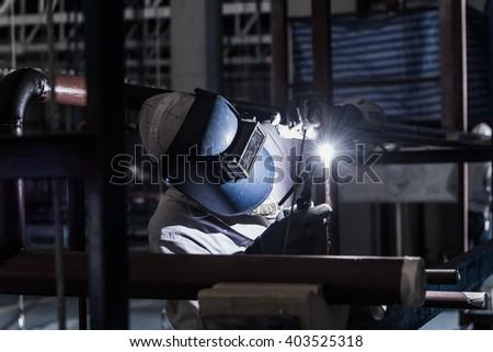 Welding steel pipe with Mig-Mag method for industrial work. Gas metal arc welding - stock photo