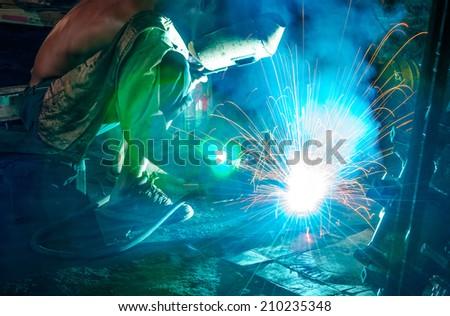 Welding steel structure in factory - stock photo