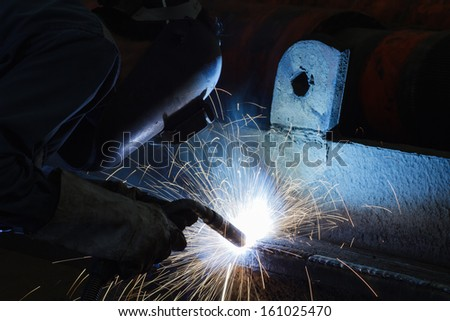 Welding steel structure in workshop  - stock photo