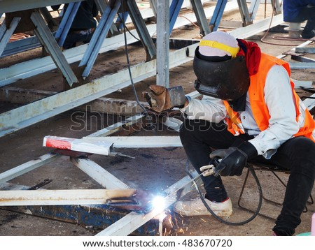 Welding work,worker with protective welding metal on construction