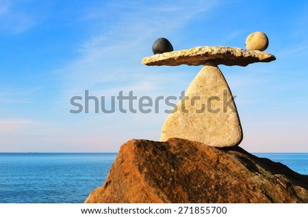 Well-balanced of stones on the top of boulder - stock photo