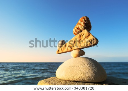 Well-balanced stack of pebbles of each other - stock photo