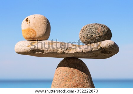 Well-balanced stack of pebbles on the shore - stock photo