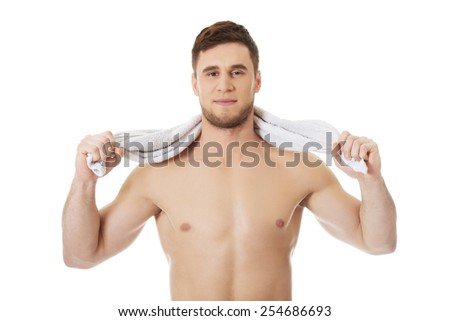 Well build handsome man with a towel around neck.