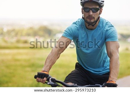 Well built man riding a bike