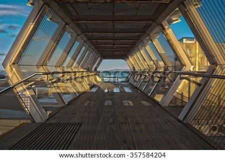 well diamond shaped tunnel bridge on the coast blue sky - stock photo