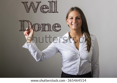 Well Done - Beautiful girl touching text on transparent surface - horizontal image - stock photo