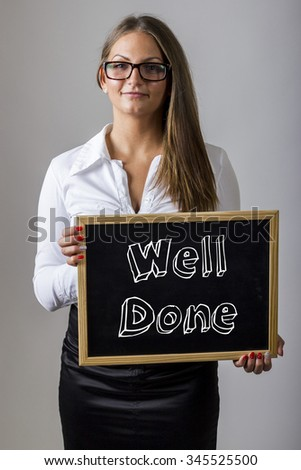 Well Done - Young businesswoman holding chalkboard with text - vertical image - stock photo