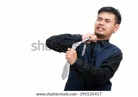 Well dressed business man adjusting his necktie on white background