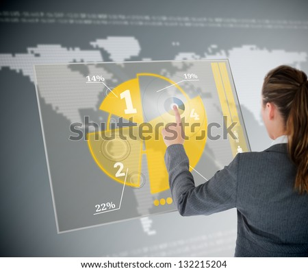 Well dressed business woman using yellow pie chart futuristic interface with map on background - stock photo