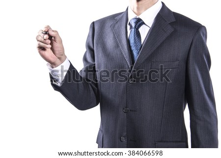 Well-dressed businessman holding pen for writing against white background.