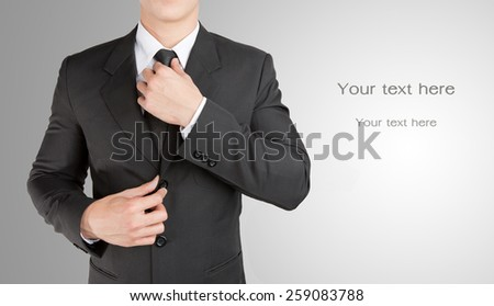 Well dressed businessman looklike smart adjusting  his neck tie : fill text - stock photo