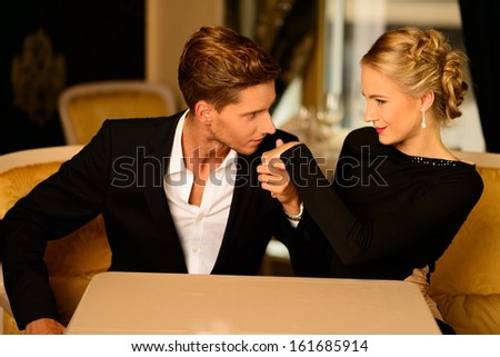 Well-dressed couple in luxury interior  - stock photo