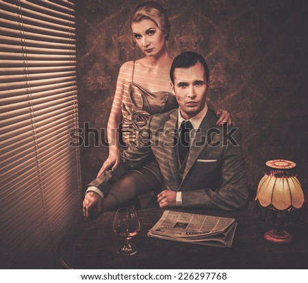 Well-dressed couple sitting behind table