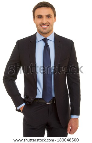 Well-dressed man in suit and tie. Charismatic businessman standing on white background - stock photo