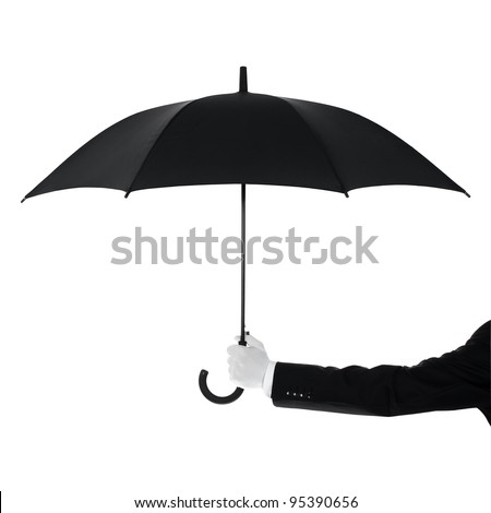 Well dressed man protecting Your text or product with an umbrella - stock photo