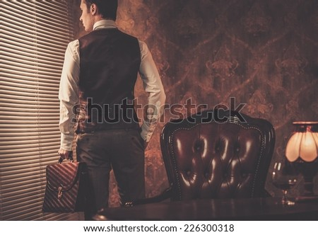 Well-dressed man with a briefcase - stock photo