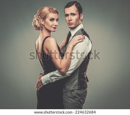 Well-dressed retro couple  - stock photo