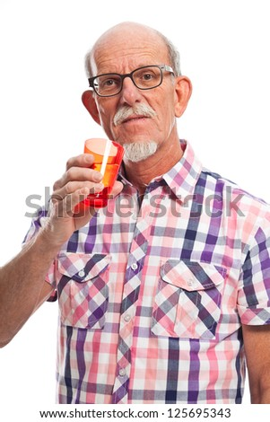 Well dressed senior man holding glass of water. Isolated.