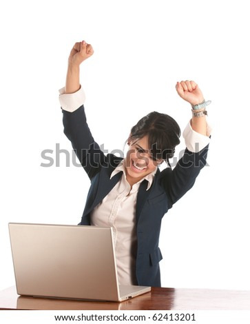 Well dressed woman lifting her arms with excitement using her laptop