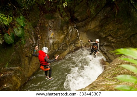 Well Equipped Man Jumping Into A Natural Pool During A Canyoning Expedition