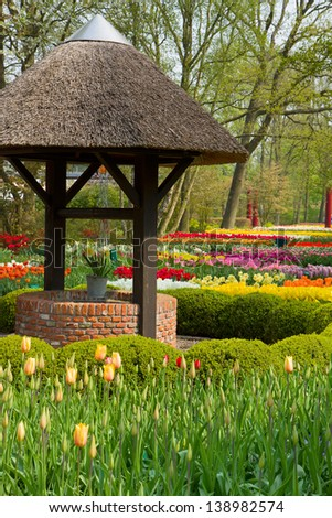 well  in spring  garden Keukenhof, Holland - stock photo