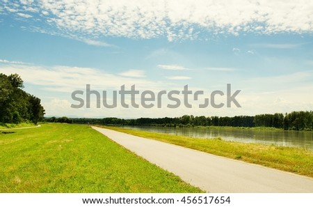 Well known Danube cycle trail running along the Danube river in Austria in the summer. Danube bicycle track is among the most beautiful, oldest and longest cycling tracks in Europe. - stock photo