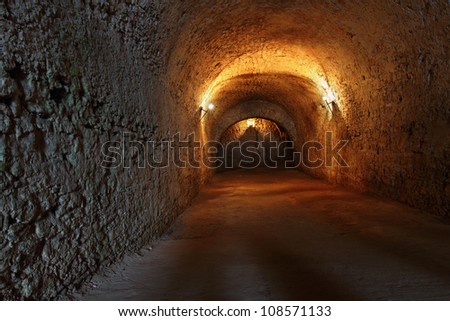 Well lit catacombs of the castle in Dubno, Ukraine
