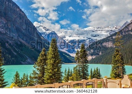 Well quay at Lake Louise. The lake is surrounded by mountains, glaciers and pine forests. Banff National Park, Rocky Mountains, Canada - stock photo