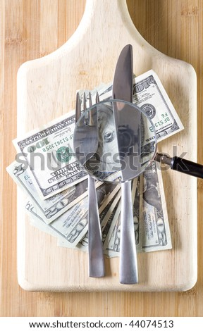 Well used chopping board and dollar