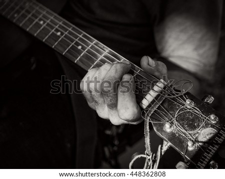 Well used guitar being played by a street musician in a Washington DC  park. - stock photo