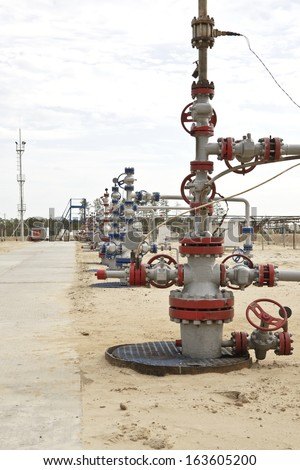 Wellhead in the oil and gas industry - stock photo