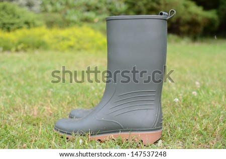 Wellington boots on grass in the garden - stock photo