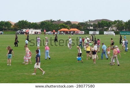 WELLINGTON, FLORIDA - APRIL 5: Halftime tradition of the divot stomp with champagne and ice cream at the 105th US Open Polo Championship in Wellington April 5, 2009 in West Palm Beach, Florida.
