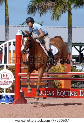 WELLINGTON, FLORIDA - MAR 10: Devon Mac Neil and Verdicchio clear a jump while competing in the SFla SportChassis Low Junior Jumper class at WEF on March 10, 2012, in Wellington, Florida.