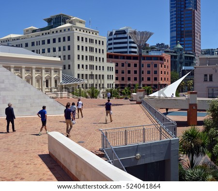 Wellington, New Zealand - November 18, 2016: Wellington downtown CBD Architecture including new buildings, walkways and pedestrians walking at lunchtime.