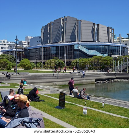 Wellington, New Zealand - November 18, 2016: Wellington people and visitors enjoying Spring sunshine at lunchtime on the grass outside the Town Hall building.