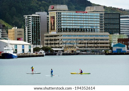 WELLINGTON, NZL - FEB 22 2013:People rowing in Wellington harbor. The 2014 Mercer Quality of Living Survey ranked Wellington 12th in the world.