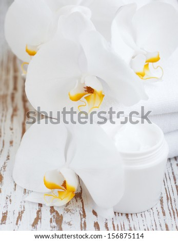 Wellness and spa scene with orchids and beauty cream - stock photo