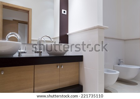 Wellness bathroom interior washbasin furniture and toilet - stock photo