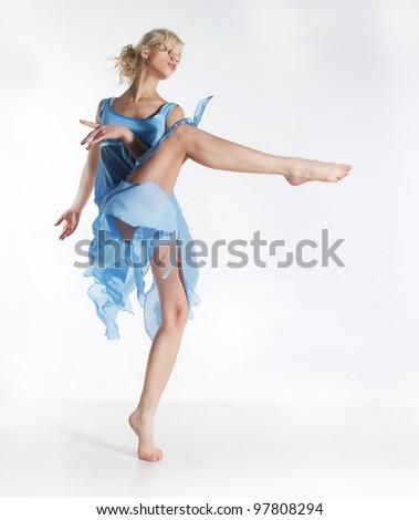 Wellness. Beautiful sexy slim woman dancing in cyan dress  - series of photos - stock photo