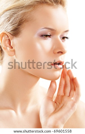 Wellness, healthcare, skin care. Close-up portrait of beautiful woman model, which touching her face isolated on white background. Perfect spa beauty with healthy skin