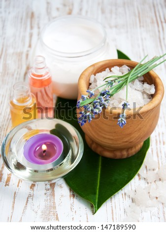 wellness products -  candle, lavender and bath-salt - stock photo
