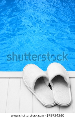 wellness slippers on pier with space for text - stock photo