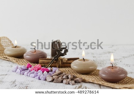 wellness travel concept with door key and candles