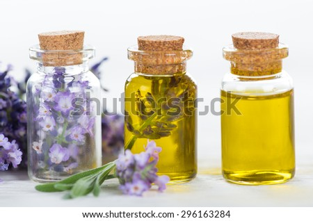 Wellness treatments with lavender flowers on wooden table. Spa still-life. - stock photo