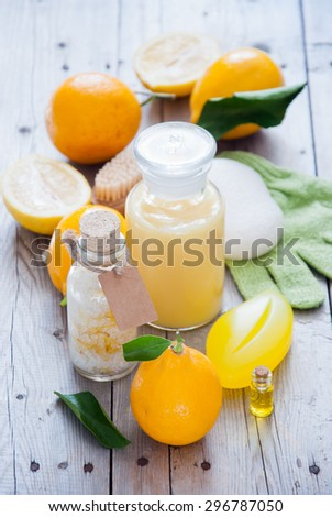 Wellness with Lemon, Lemon bath, Spa still life of organic soap, salt scrub,oil, Cosmetic cream, Shower gel and lemon - stock photo