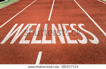 Wellness written on running track
