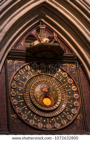 WELLS CATHEDRAL, SOMERSET, ENGLAND - October 7, 2014: Wells Cathedral clock is the second oldest clock mechanism in Britain, made about 1390. Jousting knights rush around every quarter hour.