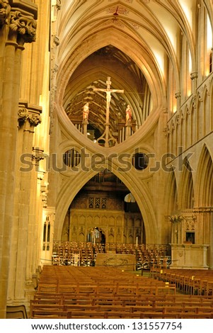 "WELLS, ENGLAND-MARCH 23:Visitors to Wells Cathedral on March 23, 2012 enjoy its architectural splendor.  Wells Cathedral has been described as ""the most poetic of the English Cathedrals""."